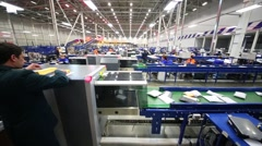 Workers of automated sorting center Russian Post in Vnukovo. Stock Footage