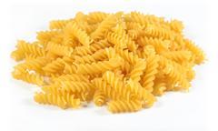 Heap of uncooked italian pasta fusilli on a white - stock photo