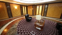 Comfortable room with a leather furniture and abstraction floor Stock Footage