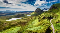 Dynamic sky over valley in mountain Quiraing, Scotland, 4k, timelapse Stock Footage