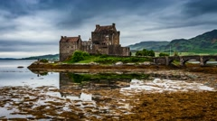 Eilean Donan Castle with tide on lake in Scotland, 4k, timelapse Stock Footage