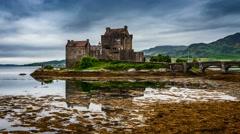 Eilean Donan Castle with tide on lake in Scotland, 4k, timelapse - stock footage