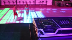 Desk for DJ near two dancers dancefloor at the night. Stock Footage