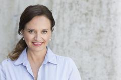 Portrait of smiling mature woman - stock photo