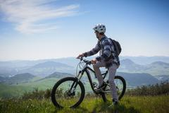 Cyclist mountain biking, San Luis Obispo, California, United States of America - stock photo