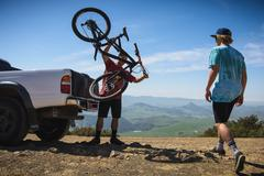 Cyclists preparing for mountain biking, San Luis Obispo, California, United - stock photo