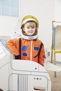 Portrait of young girl, wearing astronaut outfit Stock Photos