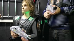 Little girl is standing and holding plastic weapon for laser tag. Stock Footage