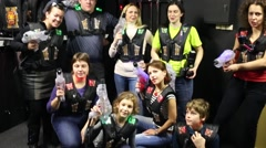 Seven people are standing and holding plastic gun for laser tag. Stock Footage