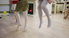 Five little girls are dancing on the floor at birthday party. Stock Footage