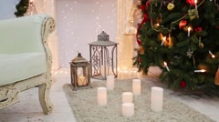 Beautiful decoration with artificial fir, sofa and garlands. Stock Footage