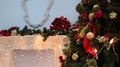 Beautiful decorated artificial fir with shelf and garlands Stock Footage