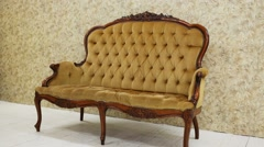 Velvet vintage sofa with carved legs is standing on the studio. Stock Footage