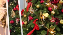 Image in mirror of beautiful decorated artificial fir with many toys Stock Footage