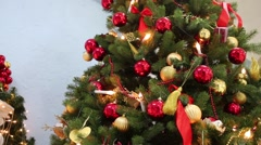 Decorated artificial fir with many toys and garlands, close up view. Stock Footage