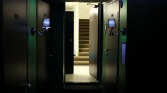 Dark corridor with doors, lamps and exit to stairwell. Stock Footage