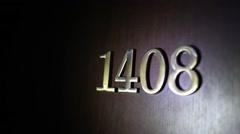 Close up of number on door illuminated flashlight in dark. Stock Footage
