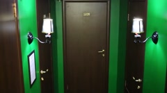 Green dark hall several with doors and flashing light. Stock Footage