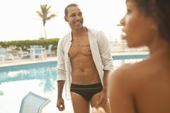 Couple in swimwear at hotel swimming pool, Rio De Janeiro, Brazil Stock Photos