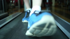 Close up sneakers man on race track in fitness club. Stock Footage