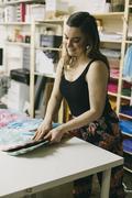Female textile designer matching textiles in design studio Stock Photos