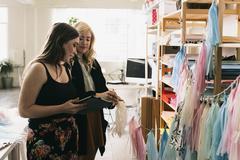 Two female designers using digital tablet in design studio Kuvituskuvat