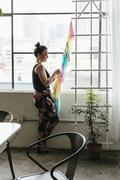 Young female designer making multi colored bunting in design studio Stock Photos