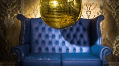 Gold blue chesterfield leather chair discoball party disco Stock Footage