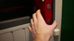 Hand closing door of small safe and turning lock close up. Stock Footage