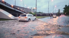 Machine leaving deep puddles on road, and other died out. Stock Footage