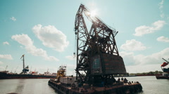 Floating crane approaches the berth shipyard taymlaps Stock Footage