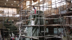 Workshop with part of monument konung Vladimir in scaffolding and journalists Stock Footage