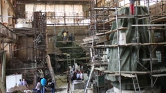 Workshop with scaffolding and monument of konung Vladimir and interview with Stock Footage