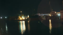 Withdrawal of the vessel from the dock at night taymlaps Stock Footage