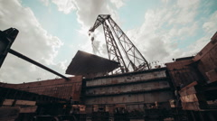 Crane holds the vessel section on the weight of the frame side taymlaps Stock Footage