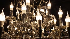 Close up of sparkling glass chandelier with bulbs in form of candles. Stock Footage