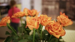 Close up of some buds of beautiful orange roses in room. Stock Footage
