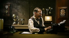 Funny senior man at work with his typewriter - stock footage