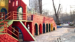 Two-storey brick playground painted in different colors. Stock Footage