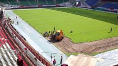 Working with tractor removing sod on Lokomotiv stadium. Stock Footage