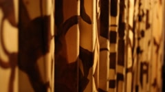 Rows of colored figures wooden bars close up on quest. Stock Footage