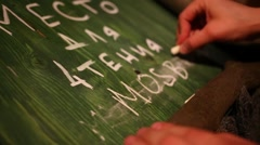 Hand writing on green board chalk close up MosBlog. Stock Footage