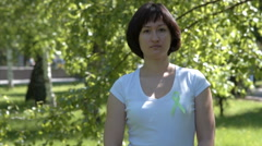 Young woman with lime green awareness ribbon Stock Footage