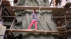 Young girl on scaffolding at monument to konung Vladimir. Stock Footage