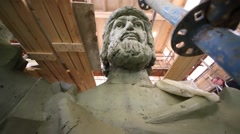 Face and shoulder of big sculpture konung Vladimir among scaffolding Stock Footage