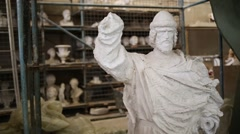 White sculpture of konung Vladimir without hands and woman behind Stock Footage