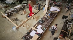 Sculpture workshop with table, instruments, materials and people. Stock Footage
