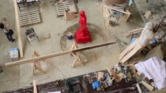 Workshop with sculptures of mans, tables, instruments on it Stock Footage