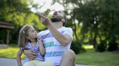Father with his little daughter outside in park Stock Footage