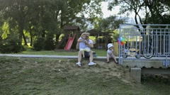 Father with his little daughters outside in park Stock Footage